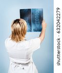 female doctor looking at an x... | Shutterstock . vector #632042279