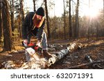 woodcutter saws a tree in the... | Shutterstock . vector #632071391