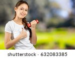 woman with a dumbbell | Shutterstock . vector #632083385