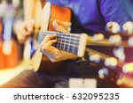man playing an acoustic guitar... | Shutterstock . vector #632095235