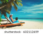 young woman with laptop on beach | Shutterstock . vector #632112659