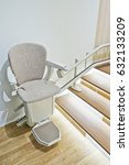 Small photo of Automatic stair lift for elderly people in a house.