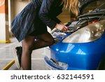 woman near car's hood. young... | Shutterstock . vector #632144591