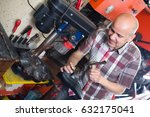 cheerful mature workman... | Shutterstock . vector #632175041