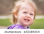 close up of an adorable 2 year... | Shutterstock . vector #632184314