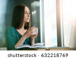 young female freelancer sitting ... | Shutterstock . vector #632218769