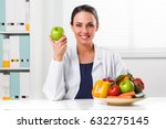 Smiling Female Nutritionist...