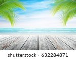 empty wooden table and palm... | Shutterstock . vector #632284871
