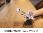hand of woman using smartphone... | Shutterstock . vector #632298911