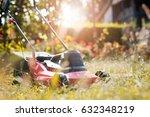 man cutting grass in his yard... | Shutterstock . vector #632348219