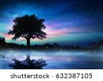 starry night with lonely tree  | Shutterstock . vector #632387105