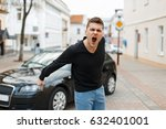 angry man screams near a car in ... | Shutterstock . vector #632401001