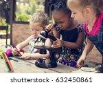little girls using microscope... | Shutterstock . vector #632450861
