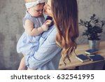 happy mother and baby playing... | Shutterstock . vector #632541995