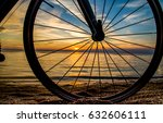 Bicycle Wheel Sunset Beach