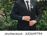 the groom in a suit and tie is... | Shutterstock . vector #632649794
