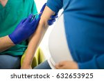 doctor vaccinating young... | Shutterstock . vector #632653925