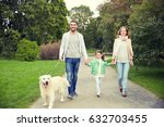Stock photo family pet domestic animal and people concept happy family with labrador retriever dog walking 632703455
