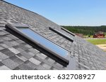 Small photo of Attic skylight. Asphalt Shingles House Roofing Construction with Attic Roof windows, skylights waterproofing.