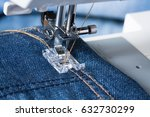 Jeans. Foot Of Sewing Machine...