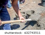 concreting of concrete manually | Shutterstock . vector #632743511