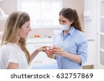 orthodontist woman shows tool... | Shutterstock . vector #632757869