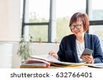 senior businesswoman working... | Shutterstock . vector #632766401