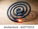 burning mosquito coil is an... | Shutterstock . vector #632772515