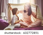 a nice girl and her mother... | Shutterstock . vector #632772851