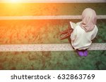 muslim woman reading holy quran | Shutterstock . vector #632863769