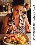 brunette woman dining in the...   Shutterstock . vector #632867135