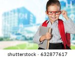 child with book and backpack. | Shutterstock . vector #632877617