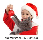 Little girl in Christmas hat with gray kitty and decoration, isolated on white - stock photo