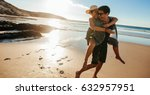 man giving piggyback ride to... | Shutterstock . vector #632957951