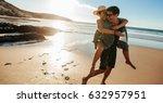 man giving piggyback ride to... | Shutterstock . vector #632957951