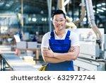 worker in his carpenter... | Shutterstock . vector #632972744