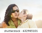 Son Kissing Mother On Cheek...
