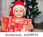 little girl in santa hat | Shutterstock . vector #63298975