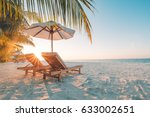 Beautiful beach. Chairs on the sandy beach near the sea. Summer holiday and vacation concept. Inspirational tropical beach. Tranquil scenery, relaxing beach, tropical landscape design. Moody landscape