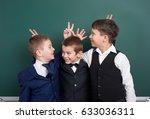 elementary school boy fooling... | Shutterstock . vector #633036311