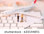 Small photo of Miniature people: Businessman standing on credit card with airplane and notebook keyboard, Technology Online shopping and Security Authorization Access code background concept