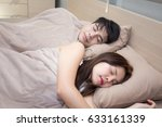 asian man and woman sleeping on ... | Shutterstock . vector #633161339