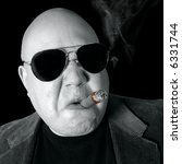 Small photo of The Loan Shark, Boss, Head Honcho, Top Dog... An image of the Man in charge, smoking a cigar.