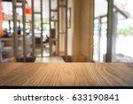 empty wooden table in front of... | Shutterstock . vector #633190841