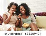 Female Friends Eating Potato...