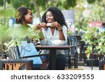 pretty women having tea in... | Shutterstock . vector #633209555