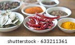 spices on a wooden table | Shutterstock . vector #633211361