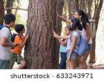 Teacher And Children Touching...
