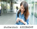 woman working on cellphone in... | Shutterstock . vector #633286049