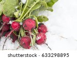 radish in the snow. spring... | Shutterstock . vector #633298895